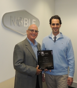 Derek Morrow, IADC Regional Representative, presented Kirk Atkinson, Noble Drilling with the Offshore Winners plaque at the Noble offices in Perth