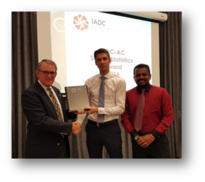 Mark Denkowski, IADC Executive Vice President, Operational Integrity presents the offshore safety award plaque to Sebastian Van Diemen, Noblecorp Drilling Superintendent and Yoga Rajan, Noblecorp Regional HSE Supervisor.