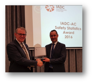 Mark Denkowski, IADC Executive Vice President, Operational Integrity, presents the onshore safety award plaque to Leigh Foreman, SLB Operations Manager.