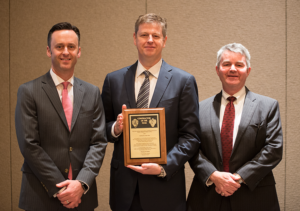Tom Burke (middle), President and CEO of Rowan Companies, received the 2017 IADC Contractor of the Year award from IADC President Jason McFarland (left) and Clay Williams, President and CEO of National Oilwell Varco, at the 2017 IADC Annual General Meeting in Austin, Texas, on 10 November
