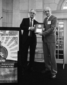 Stephen Colville, IADC president and CEO, presents the award to Precision Drilling's Niels Espeland.