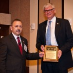 2012 IADC Contractor of the Year Gregers Kudsk (right) receives his award plaque from Robin Macmillan of NOV, which sponsored the award, at November's IADC Annual General Meeting.